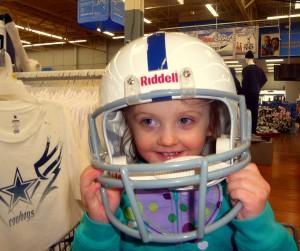 girl in football helmet